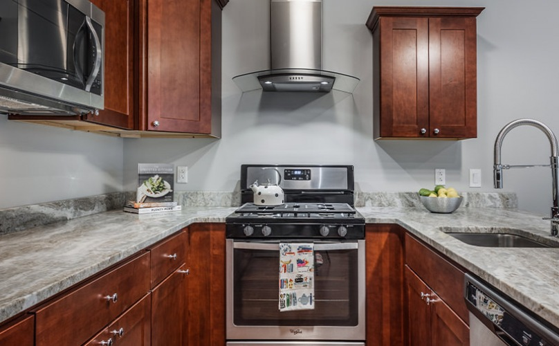Luxury kitchen with espresso cabints and a vent hood