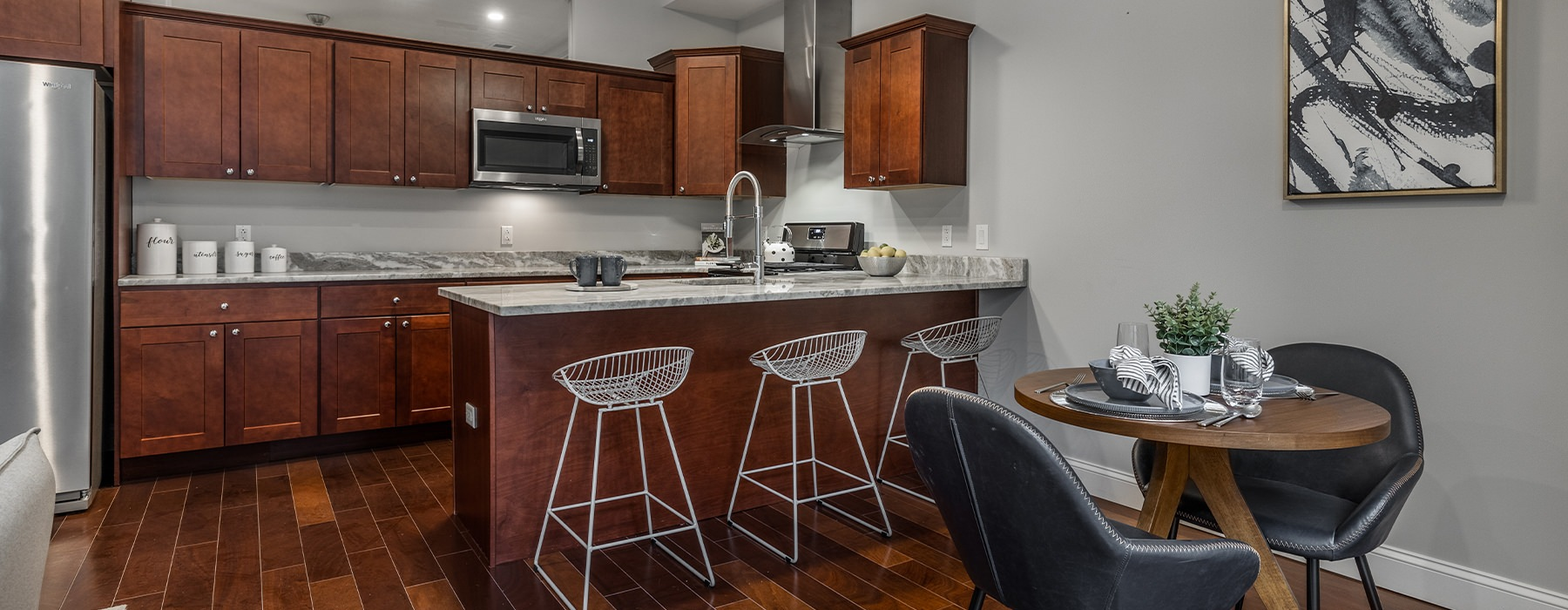 Kitchen with an eat-in bar, open to dining space